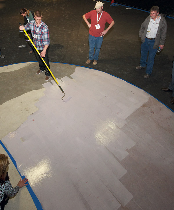 Applying concrete coatings