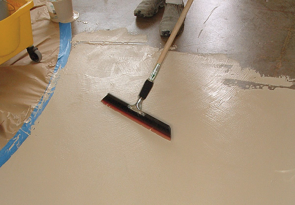 Using a squeegee for concrete coatings