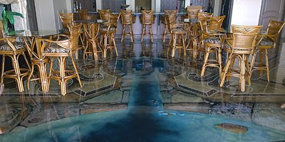 A 3-D painted concrete fish pond in a restaurant lounge makes and elegant appearance.
