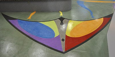 Decorative microtopping concrete floor - The artwork depicts kites, after all. No doubt youthful patients warm to the imagery and the idea behind its creation -- a diversion in an otherwise angst-generating setting (the dentist's office) that also serves as a fun, innovative way to guide patients and parents to the proper doors.