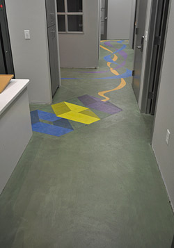 wayfinding on a colorful concrete floor