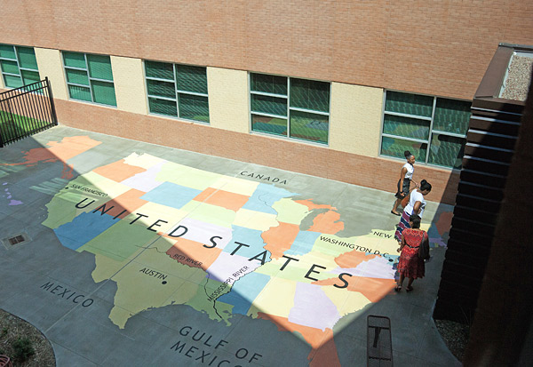 Stenciled concrete map of the United States using an acrylic concrete overlay from Elite Crete Systems.