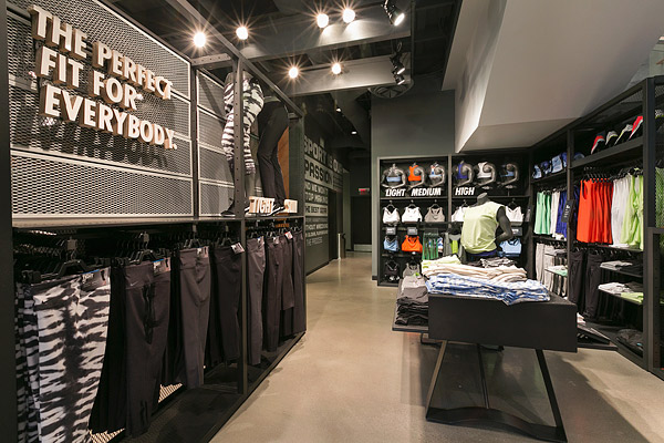 Polished aggregate floor - Concrete Decor magazine - At the new Nike Running store at The Grove in Los Angeles, a polished concrete overlay was chosen to help produce the brand impression sought by Nike and architect McCall Design Group of San Francisco.