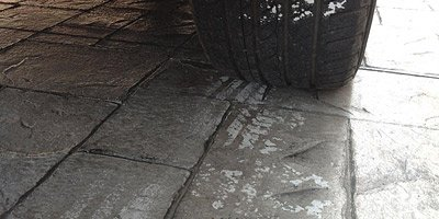 Example of hot-tire pick up on stamped concrete driveway and how to prevent sealer sticking to tires