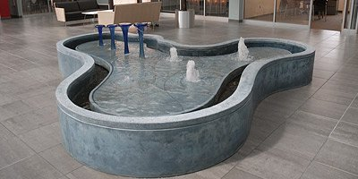 cast concrete water fountain