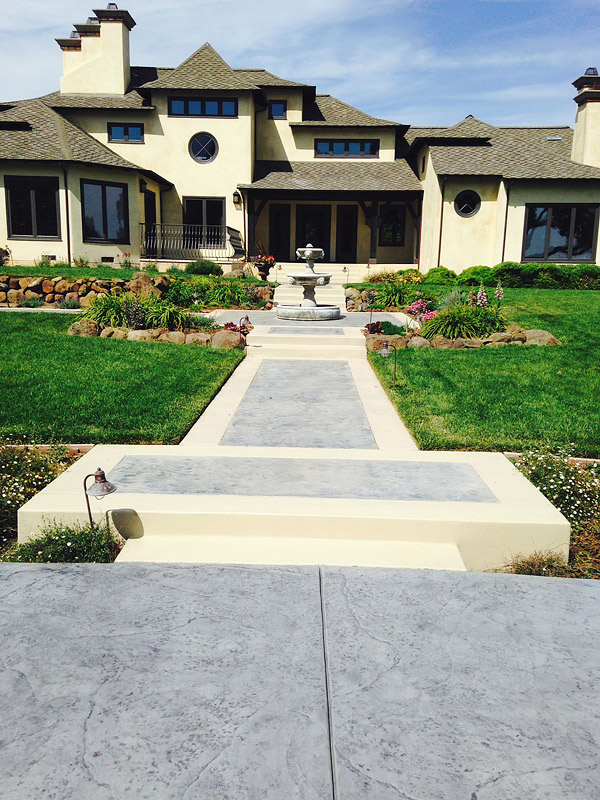 Restored decorative concrete patios and walkways,