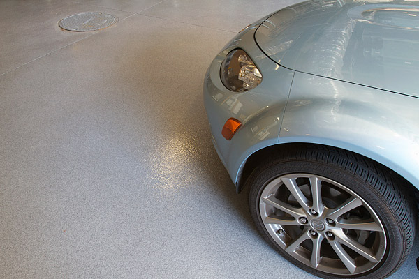 Westcoat's Dubro Quartz system on this garage floor features a colored quartz sand blend broadcast into clear epoxy. Photo courtesy of Westcoat Specialty Coating Systems
