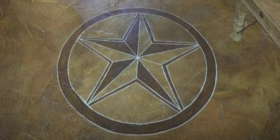Correcting Acid Stain Colors on concrete star engraved into a stained concrete overlay- Stain remains a popular finish, and while the number of problems or complaints has decreased over the last few decades, the problems remain the same, and they don't discriminate between professionals and DIY homeowners.