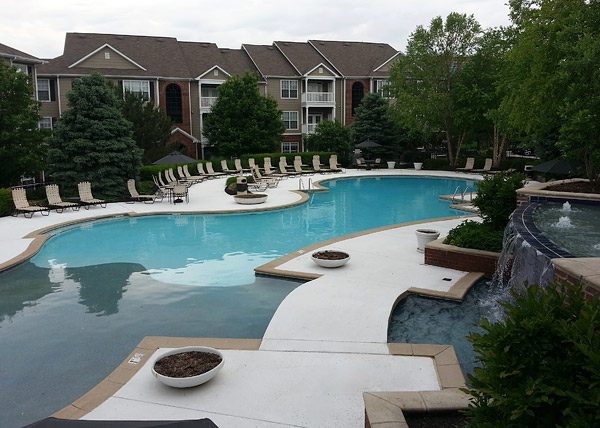 Cambridge Square Apartments Kansas concrete pool deck repair - The renewed pool deck features a knockdown texture and contrasting coping. Photos courtesy of Artistic Concrete Surfaces