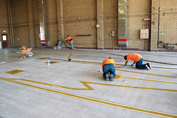 large polished concrete floor at Luke Air Force Base by Yezco Concrete Polishing outlining where the jets will park in the hangar.
