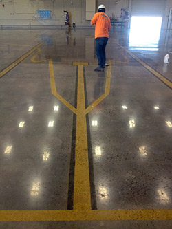 Yezco Concrete Polishing finishing a large polished concrete airplane hanger Luke Air Force Base