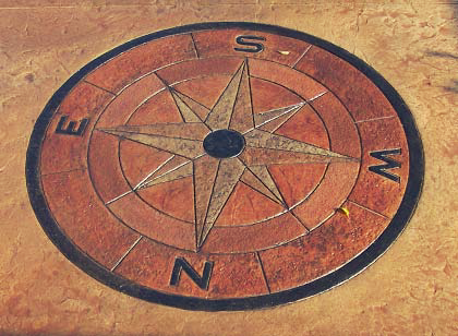 Stained concrete compass rose.