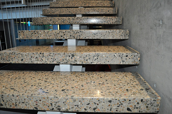 Designers are still drawn to natural concrete finishes, such as polished concrete with exposed large aggregate