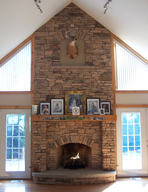 Vertical carved stone fireplace