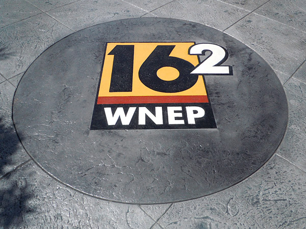 WNEP 16 logo stenciled on concrete