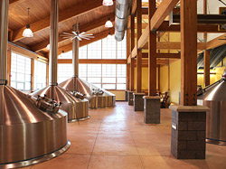 Overall, the brewery work has involved acid-stained floors, integrally colored concrete (above) and epoxied floors, concrete countertops, and a stamped wood-plank concrete patio and sidewalk leading to a beer garden.