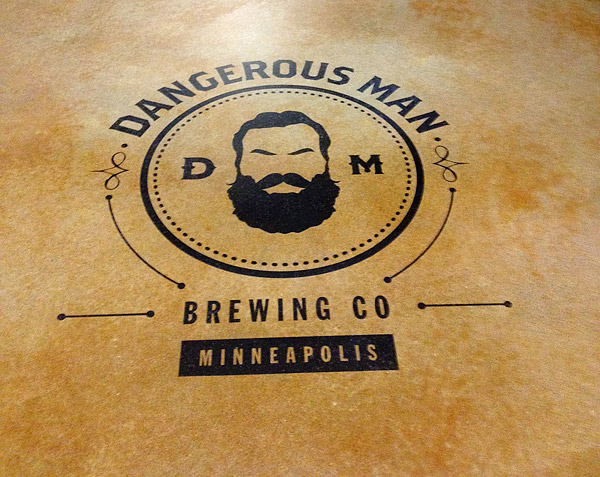 "At the barroom's entry, Warren Wert and his crew applied a one-time-use vinyl stencil of the brewery's logo so, he says, ""all the patrons entering this unique craft brewery would recognize the 'dangerous man.'"""