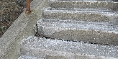 Freeze and thaw effects on concrete stairs from ice and salt.