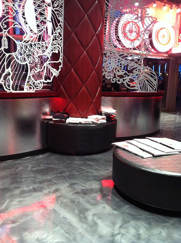 Liquid Dazzle metallic epoxy floor - Vegas Ink's newest location stands out with its Westcoat Liquid Dazzle floor. Photo courtesy of Design Concrete