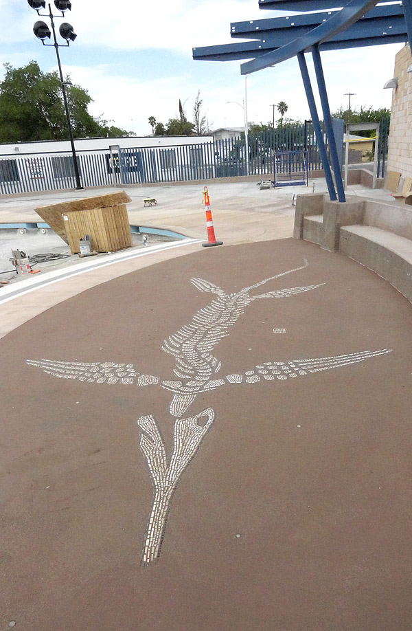 LithoMosaics icthyosaur - LithoMosaics are custom-made decorative elements assembled off site and delivered ready to install. You can see the ichthyosaur, here and above right, at the recently opened Garside community water park in town.