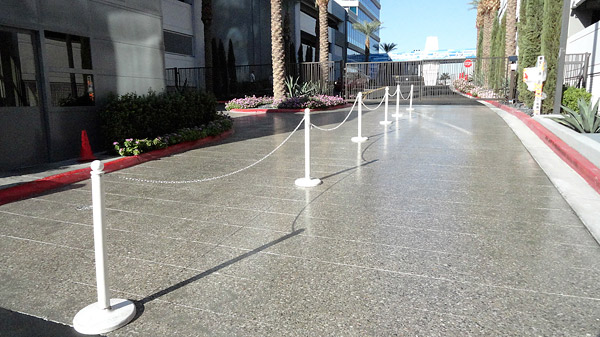 polyurethane sealed concrete - The guard gate area of Panorama Towers features concrete that was ground, honed and sealed with a polyurethane. Prior to this, the area had been stamped concrete.