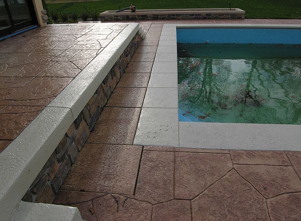 Stamped and stained concrete pool deck with the element of design placed at the top of the list.