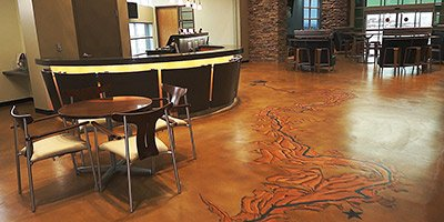 Stained stenciled concrete floor takes on the look of Grand Canyon running through this high end restaurant in Las Vegas.