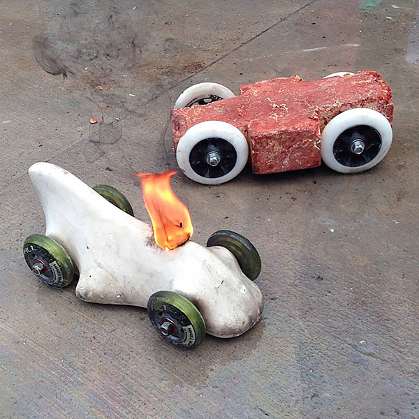 Grand prize winner Peter Cicalo's car (left, aflame) was made entirely of concrete. Buddy Rhodes' entry (right) won the most heats. Photo by Jeremy French
