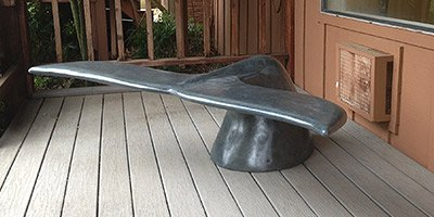 A Concrete Bench in the Shape of a Whale's Tail.