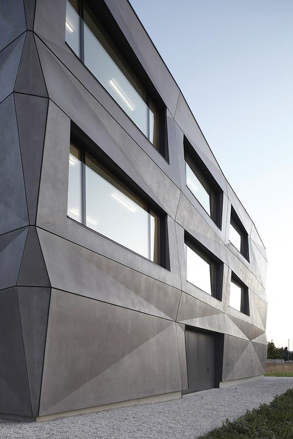 Concrete Building Facade : A folded concrete exterior mimics textiles on this munich