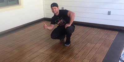 Keefe Duhon poses on his woodplank concrete