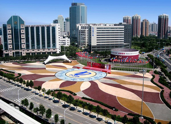 pervious concrete About 2.7 million square feet of pervious concrete was placed in Beijing, China, for the 2008 Summer Olympics. At this location, the blue and gray part of the ring in the middle is made from conventional concrete, while the center of the ring and the outer pattern are integrally colored pervious. Photo by David C. Mitchell, Bunyan Industries