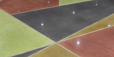 Polished concrete with different color dyes in a museum.