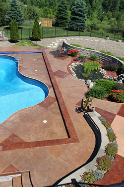 stamped stained concrete pool deck