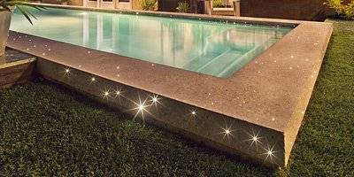 swimming pool with LED lights in the coping