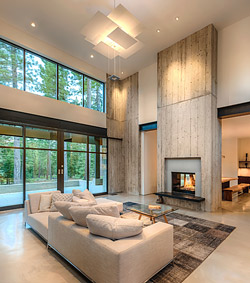 precast concrete fireplace surround and wall above in a high ceiling living room by Jimmy Hazel of Clastic Designs in Reno
