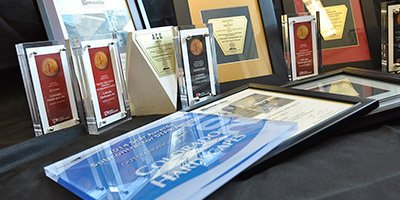 Concrete awards laid out on table