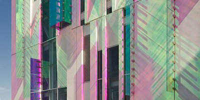 polished building facade and dichroic glass fins