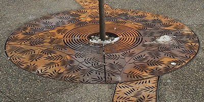 decorative drain grate in concrete beautifies an area that is usually overlooked.