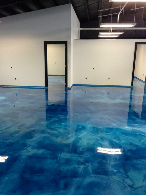 blue swirly concrete floor in a converted warehouse to a glamorous office space.