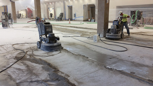 grinding a concrete floor with a polishing machine