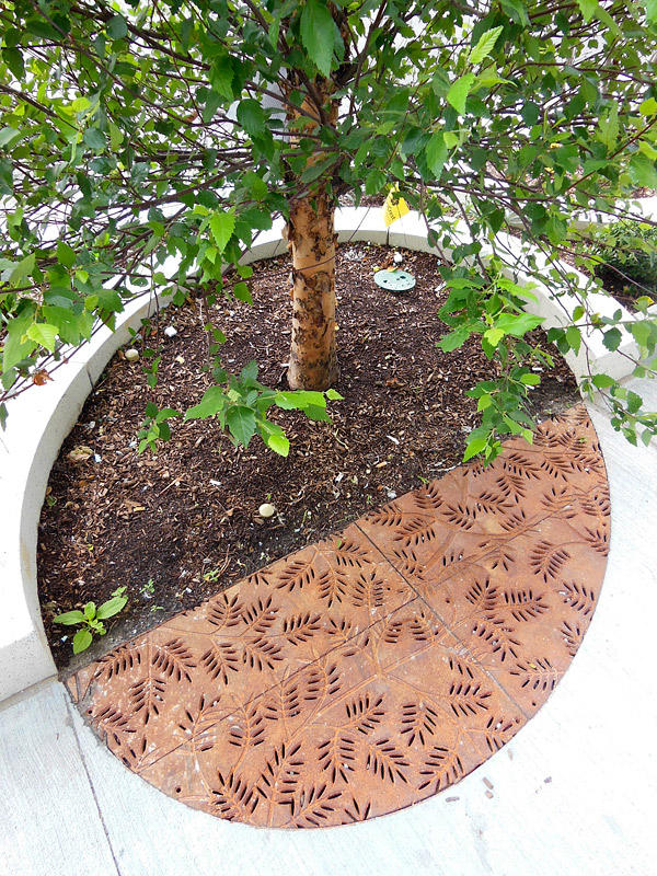 decorative grate in concrete partial tree grates from Iron Age complement surface pavers