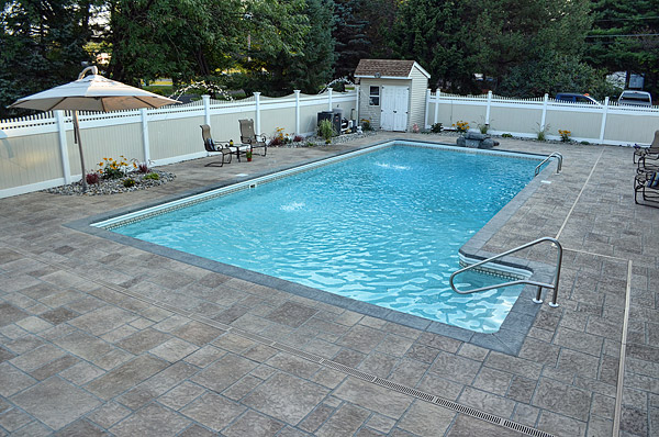 Executing a Drainage Plan for Pool Decks | Concrete Decor