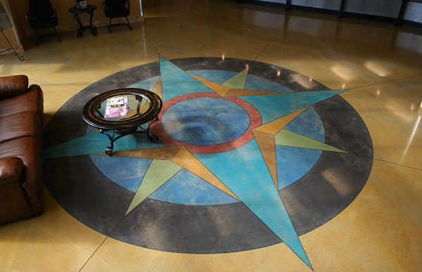 colorful concrete compass rose on yellow floor