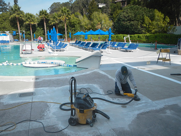 repairing a pool deck with a machine