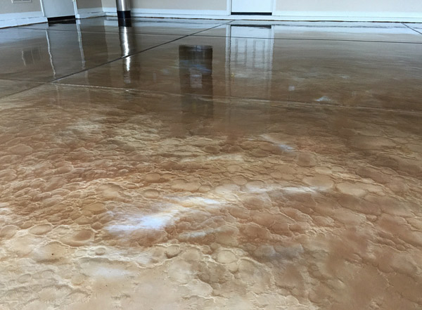 "copper metallic epoxy concrete floor - Solvents can help give a metallic floor a swirling ""movement"" and also create craters that provide a three-dimensional look."