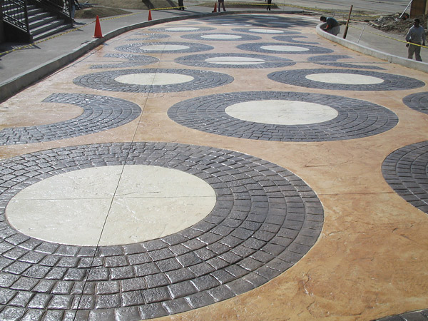 black circle stamped concrete