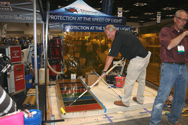 Coating specialist Scott Thome demonstrates the ease of rolling on DiamaPro UVHS at the 2015 Concrete Decor Show.