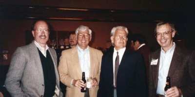 Dan Sieben, Mike Bernath, Brad Bowman and John Wilcox pose at a social dinner in the late '80s.
