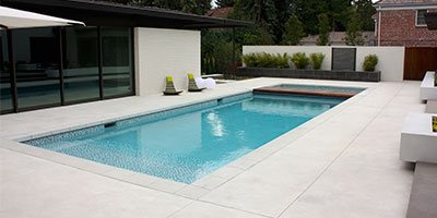 swimming pool surrounded by beautiful concrete floor